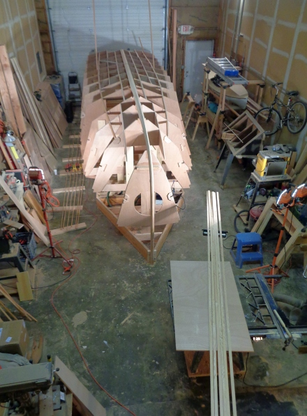 Shop is full of long, long pieces of wood