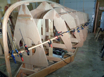 Start of the stringer lamination -- more clamps to come