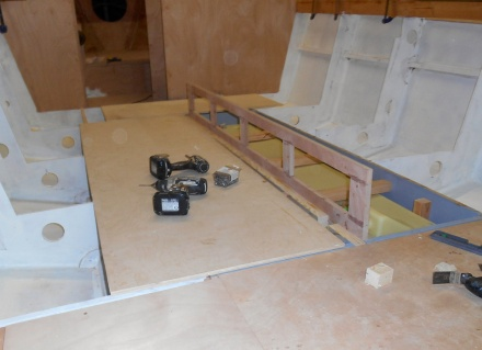 Framing for dinette -- drawers under the raised dinette floor.