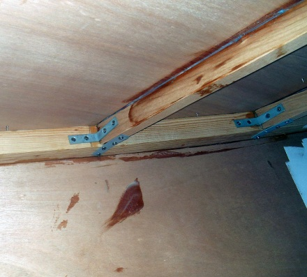 Metal straps and epoxy hold the beams in.  Lots of sqeezeout -- this is good.