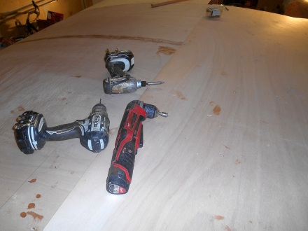 Layer two going on.   I always have a drill, impact driver and countersink chucked up (and suitably encased in epoxy).