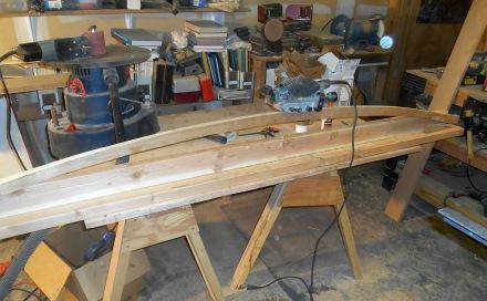 Jig for smoothing up outside edges of beams using belt sander