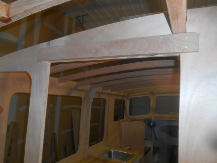 Mahogany lintel helps support the central beam and ties bulkhead parts together.