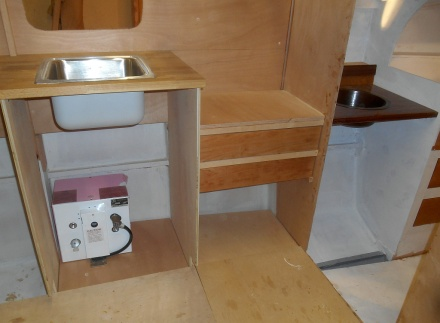 Galley drawers for cutlery and utensils.