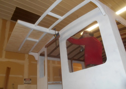 Fitting a roof panel.