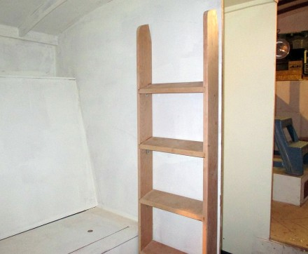 Potential ladder storage space.