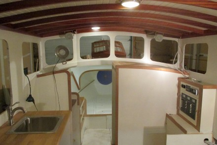 Freshly painted deckhouse with dome lights in