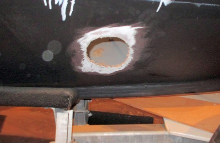Hole after cutting with plunge saw.  Too small and rough, but will gradually be brought to a tight fit with the tube using a drum sander.